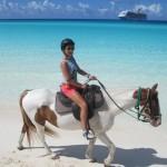 Aneliya rides a horse on the beach